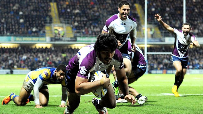 Tohu Harris of Melbourne Storm goes over for a try against Leeds.