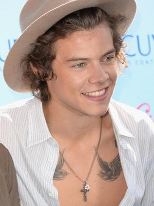 Singer Harry Styles flashes two bird tattoos on his upper chest in 2013. Picture: Jason Merritt/Getty Images
