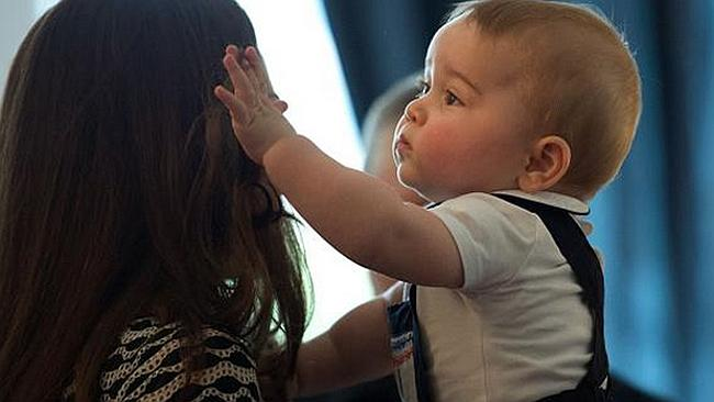 Son and hair ... Prince George seems to be as taken with his mother's famous locks as the rest of the world.