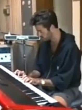 George Michael on piano.