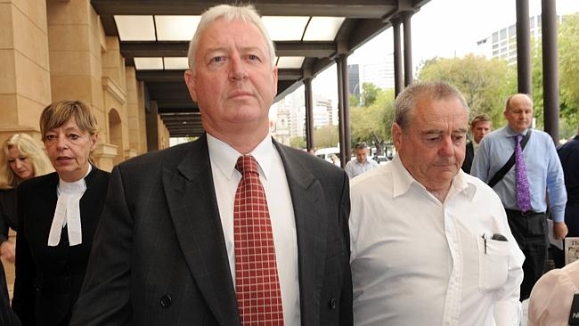Eugene and Craig McGee leave court after being acquitted of conspiracy.
