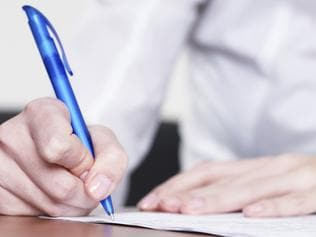Writing a letter. person using a pen to write a letter. stock image. Picture: ThinkStock