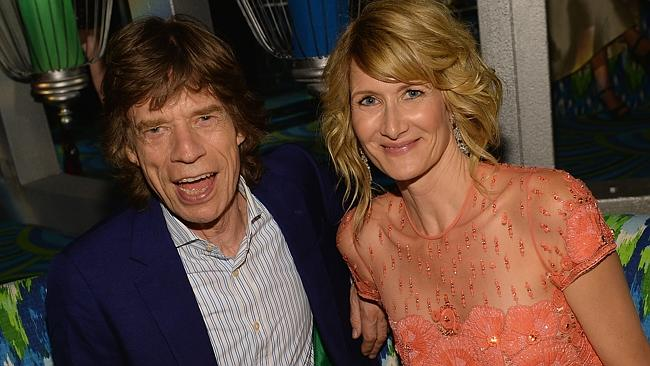 Mick Jagger poses with actor Laura Dern. Photo: Michael Buckner/Getty Images