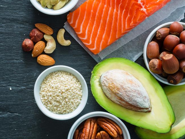 Health foods - sources of good fats include olive oil, nuts, avocado, and oily fish like salmon. IMAGE: iStock