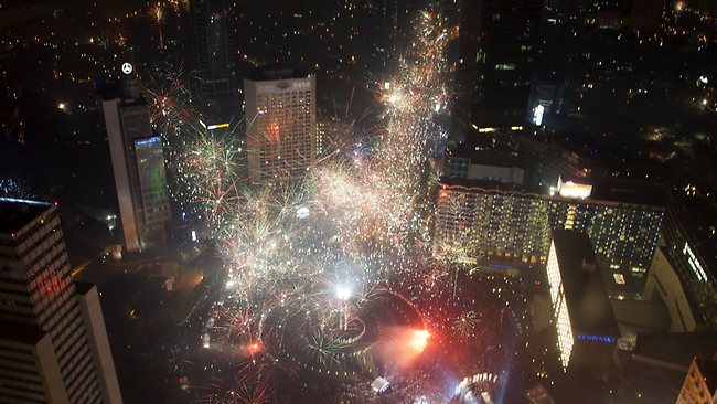 Celebration...Fireworks explode as thousands of people line the streets of downtown Jakarta to welcome in the New Year in Indonesia. Picture: AP