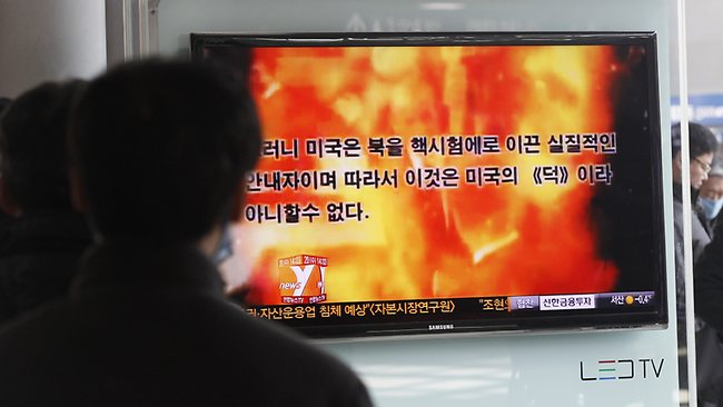 "People watch a television program showing a propaganda video released by North Korea at Seoul Railway Station in Seoul, South Korea, Wednesday, Feb. 20, 2013. The new North Korean video portrays President Barack Obama and American troops in flames and says the North conducted its recent nuclear test because of U.S. hostility. The letters on the screen read ""the U.S. hasessentially led North Koreato conduct a nuclear test so we cannot help saying we owe it to the U.S."" (AP Photo/Ahn Young-joon)"