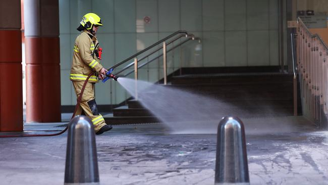 The scene where a man set himself alight outside the Australian Immigration and Visa Centre in Sydney. Picture: Brett Costello