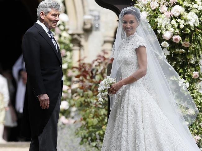 Pippa Middleton arrives with her father Michael Middleton. Picture: AP