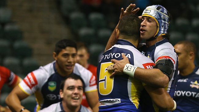 Antonio Winterstein and Johnathan Thurston celebrate after Kane Linnett of the Cowboys scored a try during the round 14 NRL match between the St George Illawarra Dragons and the North Queensland Cowboys at WIN Stadium.
