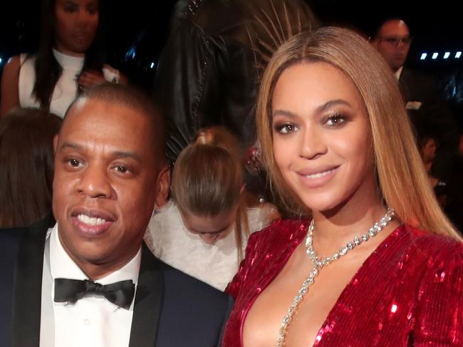LOS ANGELES, CA - FEBRUARY 12: Hip Hop Artist Jay-Z and singer Beyonce during The 59th GRAMMY Awards at STAPLES Center on February 12, 2017 in Los Angeles, California.  (Photo by Christopher Polk/Getty Images for NARAS)