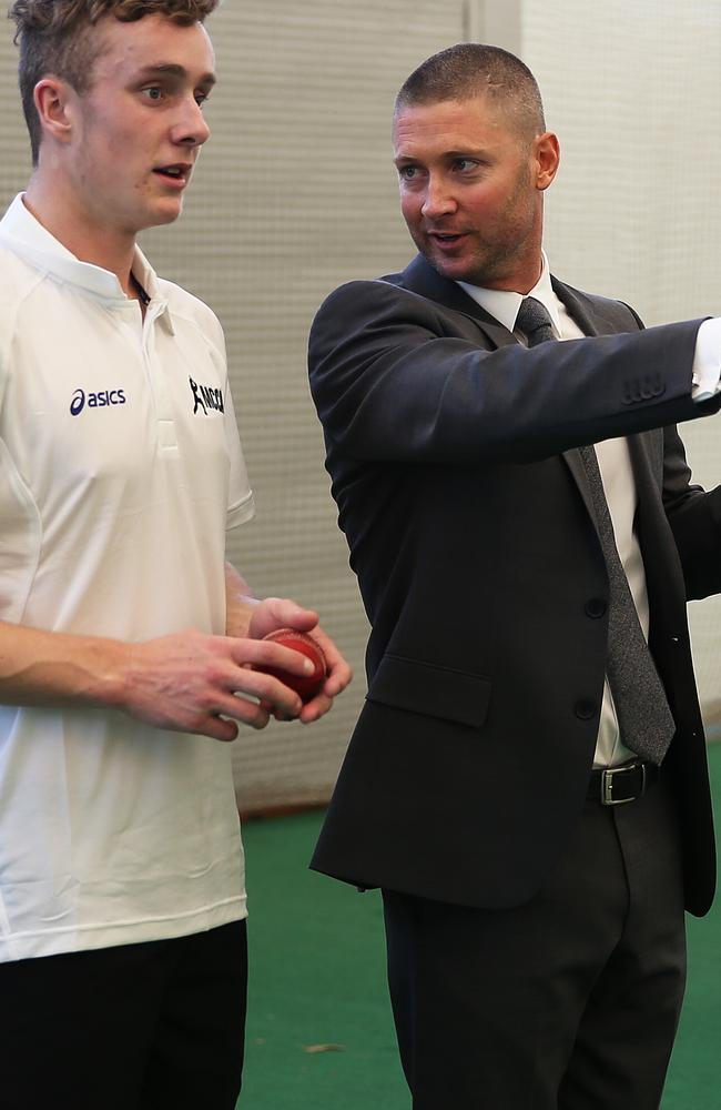 Australian captain Michael Clarke gives some tips to a young bowler at the launch of his cricket academy at the SCG.