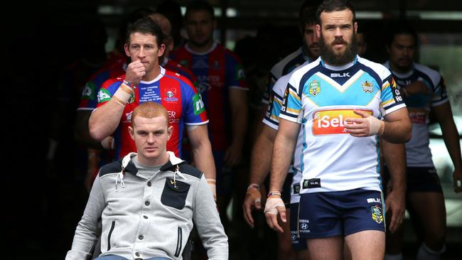 Alex McKinnon leads both teams out for The Rise For Alex game. Pic: Gregg Porteous