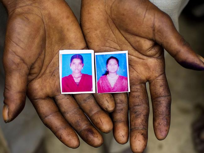 Sohan Lal (55) holds passport sized images in his hands of his daughter Murti (right) and niece Pushpa (left) who were allegedly gang-raped and murdered with their bodies found hanging from a mango tree in Katra Sadatganj village on the morning of Thursday the 29th May.
