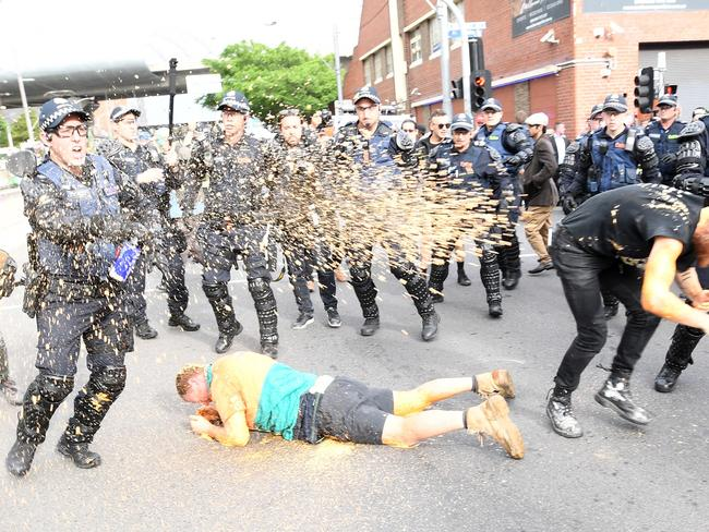 Protesters clash police in Kensington, Melbourne on Monday, after public speaker Milo Yianopoulos arrived. Picture: AAP