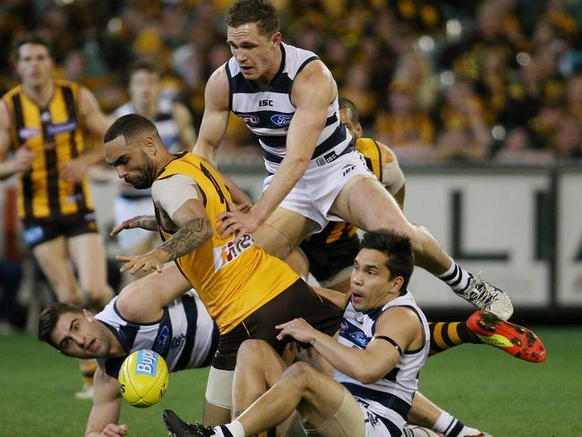 Shaun Burgoyne and Joel Selwood fight for the ball. Picture: George Salpigtidis