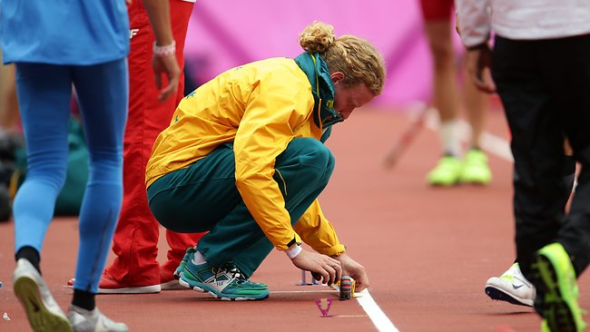 Steve Hooker marks his lines during qualification for the men's pole vault. Picture: Brett Costello