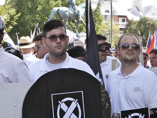 James Alex Fields Jr, left, holds a black shield belonging to the White Supremacist group Vanguard America. Picture: Alan Goffinski/AP