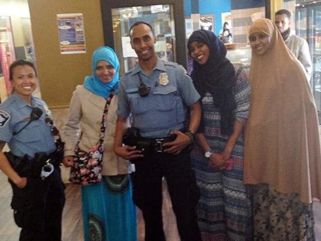 Mohamed Noor (centre) fatally shot an Australian bride-to-be. Picture: Facebook/Betsy Hodges