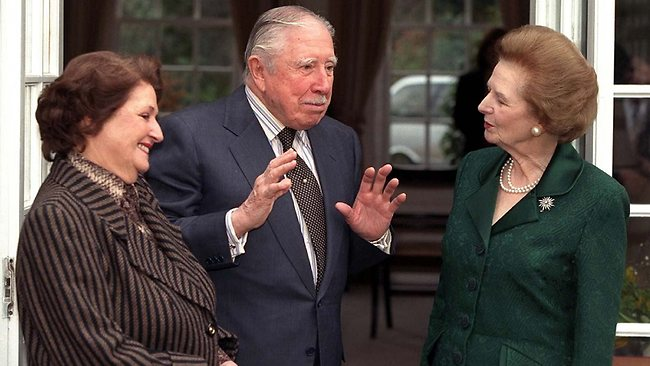 "(FILES) A file picture taken on March 26, 1999, shows Chile's former dictator General Augusto Pinochet (C) and his wife (L) being visited by Margaret Thatcher (R) at their temporary residence while under house arrest at Wentworth in Surrey, Great Britain. Former British Prime Minister Margaret Thatcher, the ""Iron Lady"" who shaped a generation of British politics, died following a stroke on Monday April 8, 2013, at the age of 87, her spokesman said. AFP PHOTO / FILES"