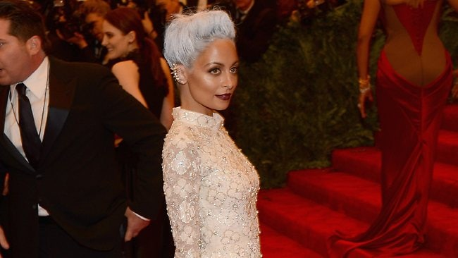 Nicole Richie, looked so good wearing custom Topshop and blue rinse hair that it made Rihanna want to throw up - but that's a good thing, apparently. Picture: Getty