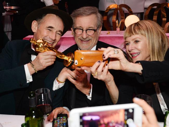 "Mark Rylance, winner of the award for best actor in a supporting role for ""Bridge of Spies"", from left, Steven Spielberg and Kate Capshaw attend the Governors Ball after the Oscars on Sunday, Picture: Al Powers/Invision/AP"