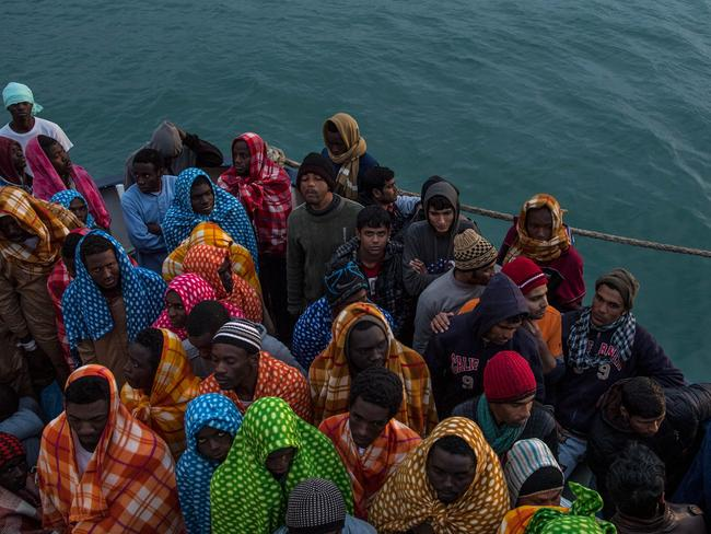People waiting on the deck of a Spanish rescue boat. Nearly 5000 people died crossing the Mediterranean last year, 700 of whom were children. Picture: David Ramos/Getty Images.