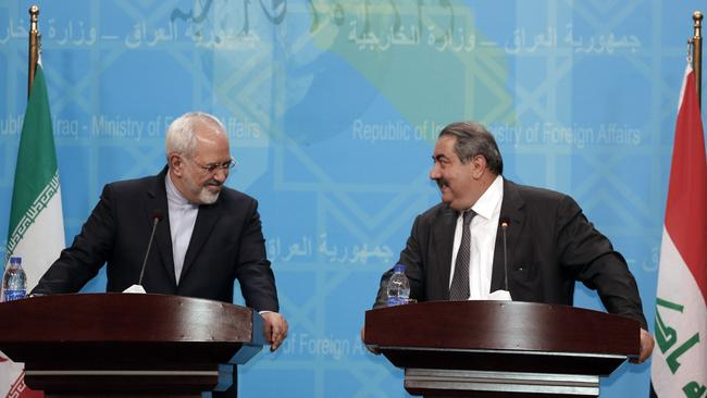 Working together to try to combat jihadist-led militants ... Iranian Minister of Foreign affairs, Mohammad Javad Zarif, (L) and Hoshyar Zebari, Iraqi Minister of Foreign Affairs. Picture: AFP