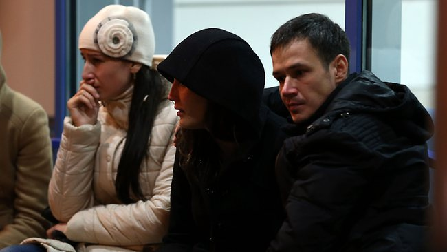 Relatives cry inside the main building of Kazan airport. Picture: AFP