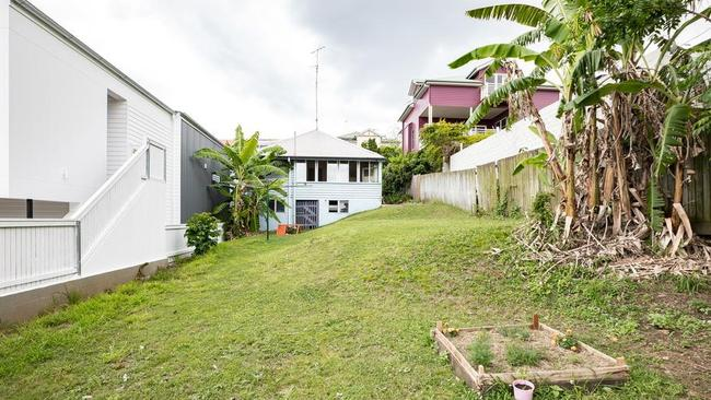 Huge homes for neighbours and a large block for development made this a definite sell before auction at 47 Wilden Street, Paddington.