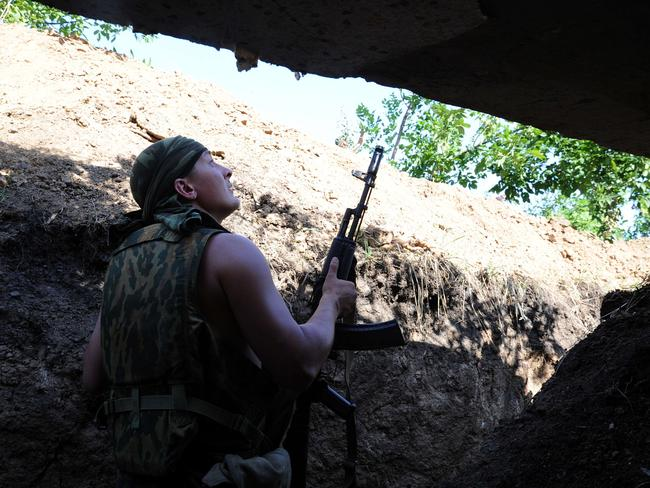 Eyes open ... a pro-Russia militant stands in a trench as he takes shelter from bombing by a Ukrainian army plane.