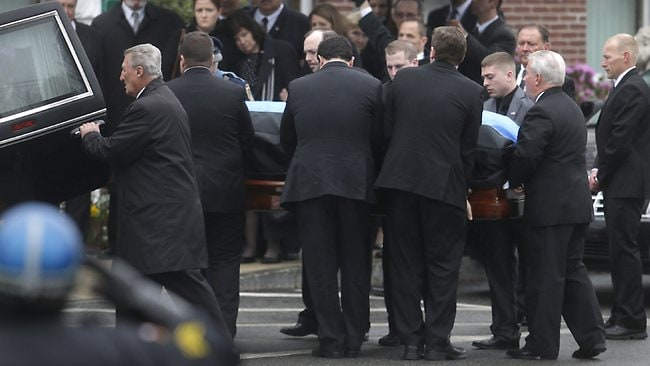Pallbearers carry the casket of fallen Massachusetts Institute of Technology police officer Sean Collier into St. Patrick's Church before a funeral Mass, in Stoneham, Mass., Tuesday, April 23, 2013. Collier was fatally shot on the MIT campus Thursday, April 18, 2013. Authorities allege that the Boston Marathon bombing suspects were responsible. (AP Photo/Steven Senne)