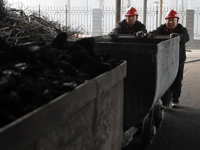 "Difficult work...One miner says his lungs ""don't hurt much"", and that he cannot afford medical care. Picture: AFP"
