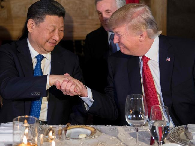 US President Donald Trump (R) and Chinese President Xi Jinping (L) shake hands during dinner at the Mar-a-Lago estate in West Palm Beach, Florida, on April 6, 2017. Picture: Jim Watson
