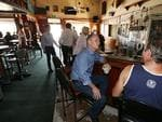 Premier Campbell Newman talks to locals in the Cooktown pub, following Cyclone Ita.