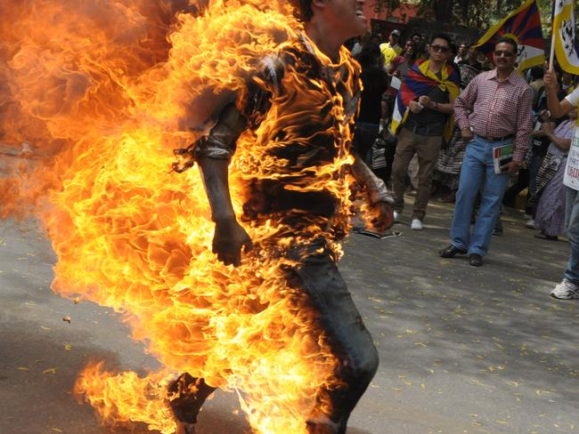 Tibetan activist Jhampel Yetshi is engulfed in flames at a protest in New Delhi, India, ahead of Chinese President Hu Jintao's visit in 2012. Photo: K Asif/India Today Group/Getty Images