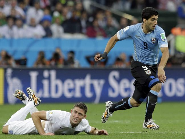Uruguay's Luis Suarez escapes ... Gary Cahill's face says it all.