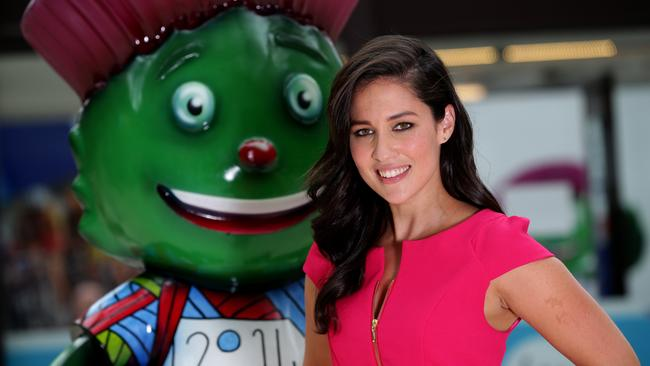"Channel 10 reporter Mel McLaughlin with creepy Games mascot ""Clyde"". Picture: Adam Head."