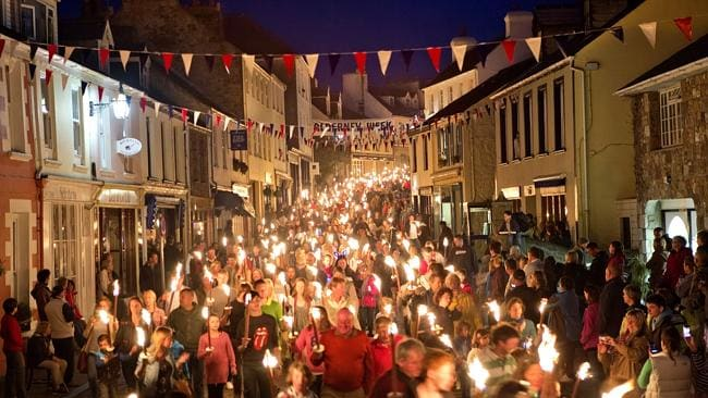 Miss Alderney leads a raucous parade down the main street of Alderney. Picture: Michael Heffernan, Lonely Planet Traveller Magazine