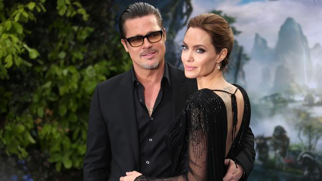 In love ... Brad Pitt and Angelina Jolie at the Maleficent exhibit in London, loved their time together in Sydney. Picture: Joel Ryan