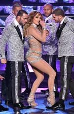 "Jennifer Lopez (C) performs with dancers during the launch of her residency ""JENNIFER LOPEZ: ALL I HAVE"" at The Axis at Planet Hollywood Resort. Picture: Ethan Miller/Getty Images"