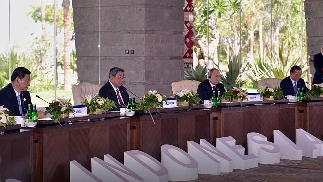 Indonesia's President Susilo Bambang Yudhoyono speaking as China's President Xi Jinping, Russian President Vladimir Putin and Australia's Prime Minister Tony Abbott look on during the Leaders Retreat during the APEC Summit. Picture: AFP
