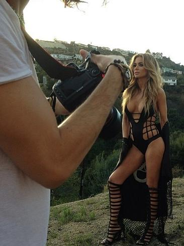 US glamour model Carmen Electra poses in knee high gladiators in a new photo shoot for Galore magazine. Picture: Instagram