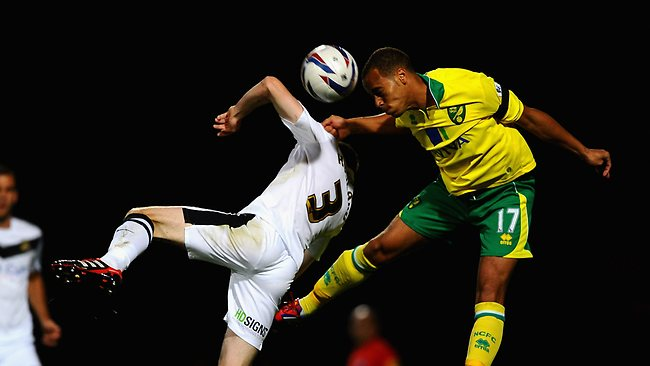 Elliott Bennett of Norwich City battles with James Husband of Doncaster Rovers during the Capital One Cup third round match at Carrow Road. Picture: Laurence Griffiths