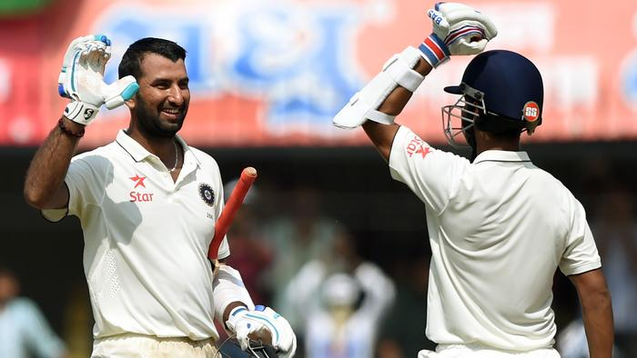 ICheteshwar Pujara (L) celebrates with Ajinkya Rahane after scoring a century.