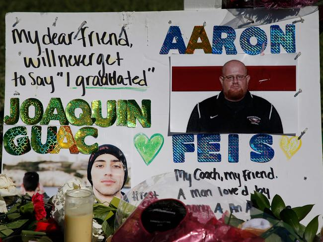 A tribute to a student and coach Aaron Feis outside Marjory Stoneman Douglas High School. Picture: AFP