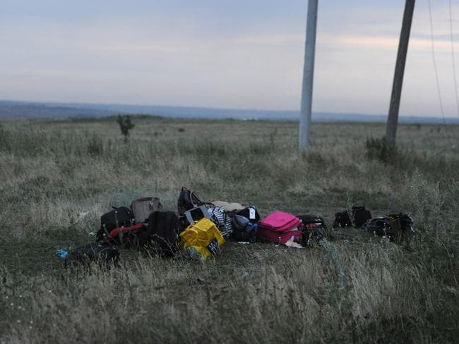 Bags are pictured at the site of the crash of MH17, near the town of Shaktarsk in rebel-held east Ukraine. Picture: AFP