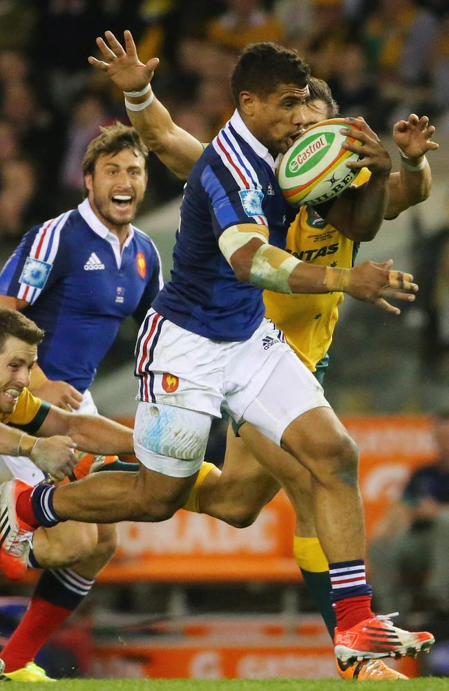 France centre Wesley Fofana tries to escape the tackle of Wallabies winger Adam Ashley-Cooper.