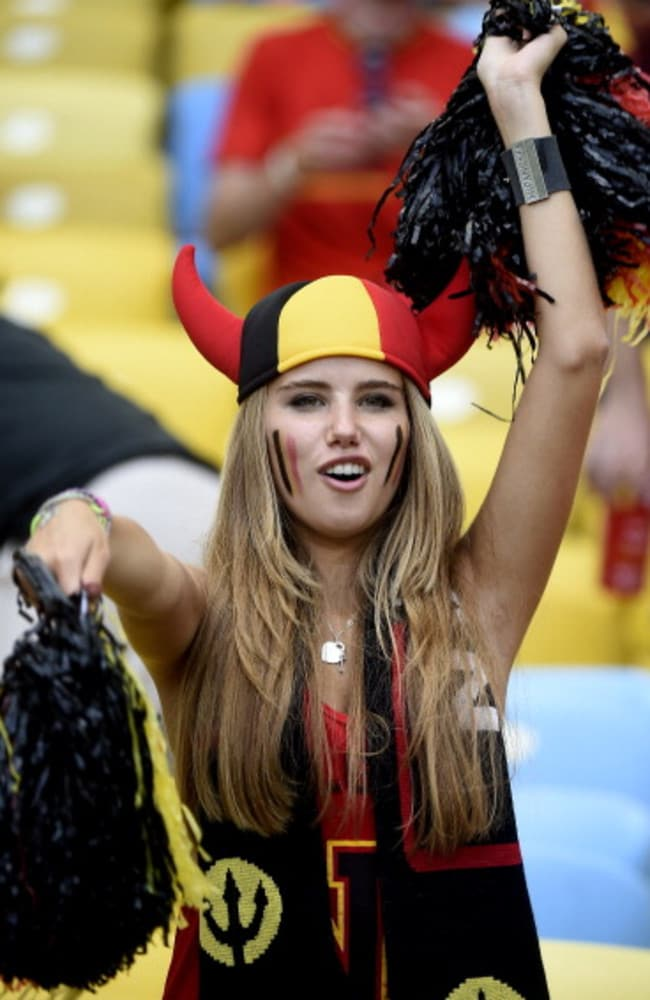 Overnight sensation ... Axelle Despiegelaere landed a modelling contract with L'Oreal Professional after this shot of her supporting her team, Belgian, at the World Cup went viral.