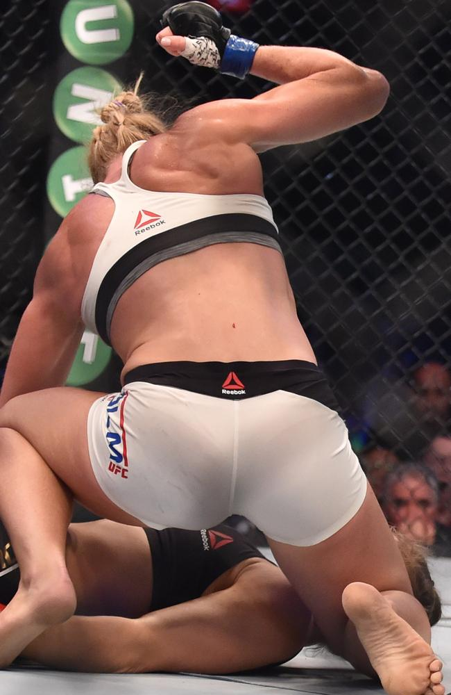 Holly Holm goes in for the final few punches. Picture: AFP/Paul Crock.