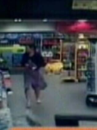 A woman is seen walking through the store the second before car enters.